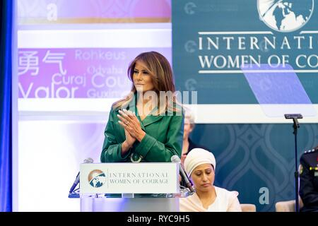 U.S First Lady Melania applauds honorees during the 2019 International Women of Courage awards ceremony at the State Department March 7, 2019 in Washington, DC. - Stock Image