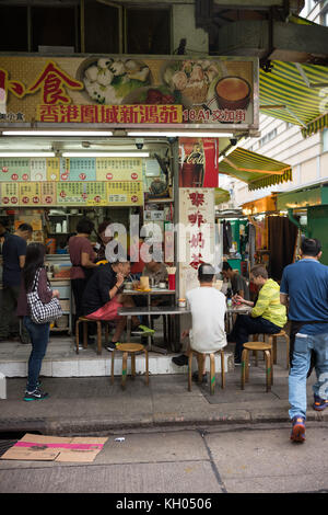Small restaurant located in the middle of Wan Chai Market - Stock Image