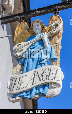 The Angel Ornate pub sign,Lavenham Town Centre, Suffolk, England, UK, GB - Stock Image