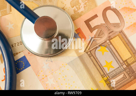A stethoscope on a fifty euro banknote - Stock Image