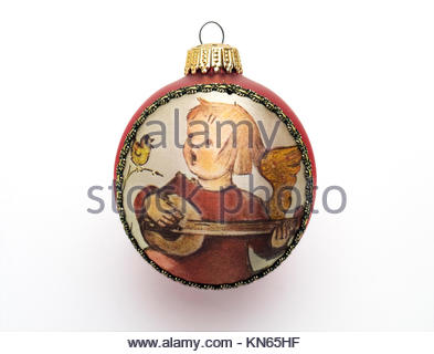 Vintage Christmas tree ornament with applied fabric image, inspired by M. J. Hummel. - Stock Image