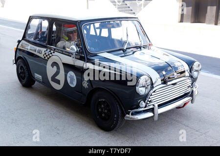 Jonathan Lewis in his 1965, Morris Mini Cooper, during the 2019 Silverstone Classic Media Day - Stock Image