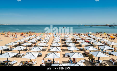 Cascais, Portugal - May 14, 2019: High perspective of crowded sandy beach in Cascais near Lisbon, Portugal in the Costa Verde - Stock Image