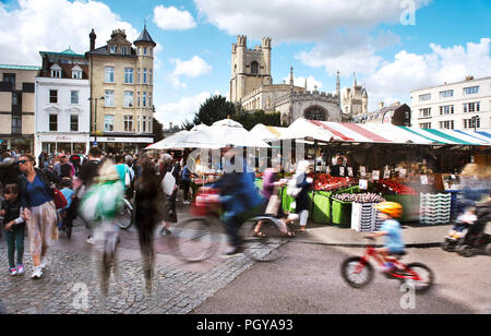 Cambridge Market on a busy saturday in Summer.Tourists and locals alike visit the market and are blurred through a long exposure - Stock Image