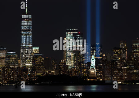 9/11 Memorial Beams with Statue of Liberty and Lower Manhattan - Stock Image