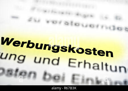 Text on page advertising costs highlight horizontal closeup - Stock Image