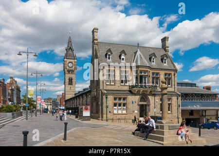 West Row Darlington with the Victorian Market Clock tower and people enjoying summer sunshine - Stock Image