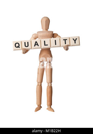 Wooden figurine with the word QUALITY isolated on white background - Stock Image