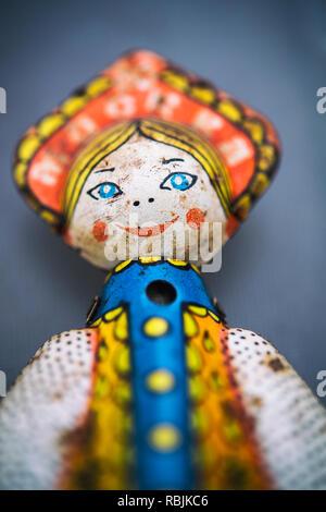 Still life on a vintage child's doll tin toy - Stock Image