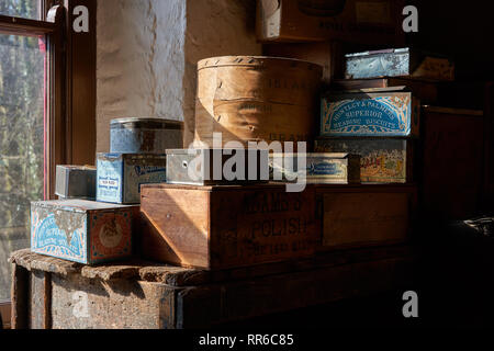 Boxes and tins in the hardware store in St Fagans Museum of Welsh Life, Cardiff - Stock Image