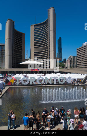 View of Nathan Phillips Square and Toronto Sign in downtown in Toronto, Ontario, Canada - Stock Image