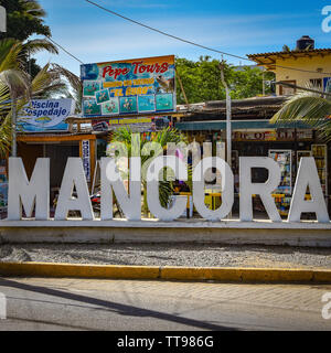 Mancora, Peru - April 18, 2019: Sign welcoming visitors to the beach town of Mancora - Stock Image