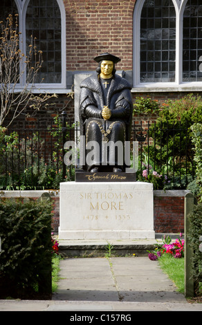 Statue of Sir Thomas More Outside Chelsea Old Church. Lord High Chancellor of England under Henry VIII. The Embankment, - Stock Image