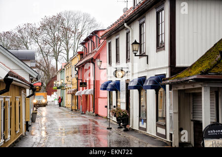 The main street of Sigtuna, a small, pretty town near Stockholm, Sweden. Quaint wooden homes; Swedish shops; typical - Stock Image