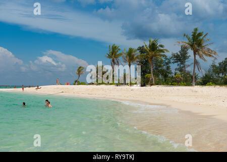 People swimming near Koh Lipe beautiful white sand beach, Thailand - Stock Image