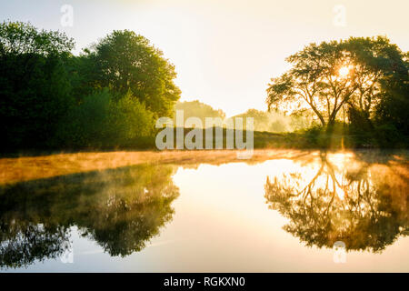 English countryside landscape. Early morning mist in May at Colwick Country Park and the River Trent, Nottinghamshire, England, UK - Stock Image