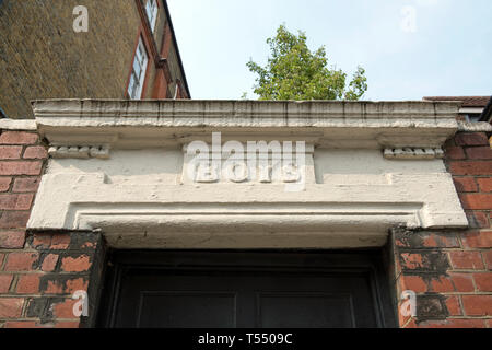 Boys entrance to old Victorian Board school, sign above door, Richie Street, London Borough of Islington - Stock Image