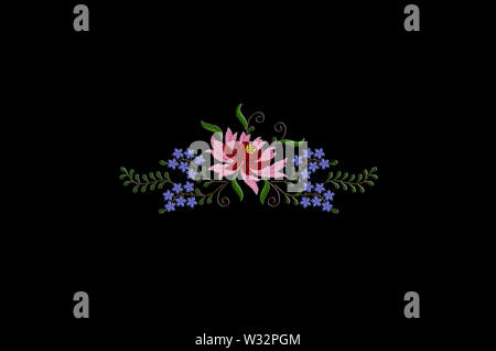 Black background with embroidery of flower with red and pink petals and small blue flowers on twisted branches with leaves - Stock Image