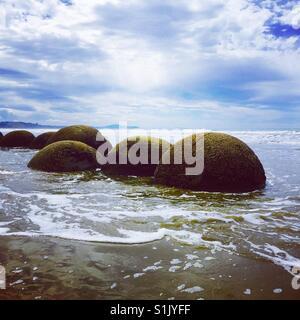 Moeraki boulder with gentle waves - Stock Image