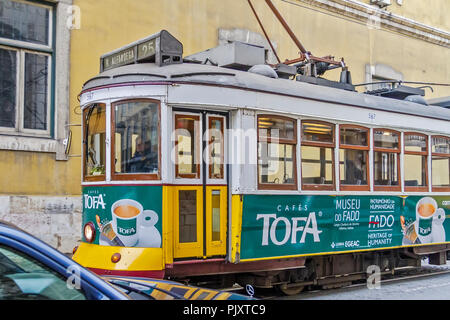 Tramcar Moving Through The Traffic Lisbon Portugal - Stock Image