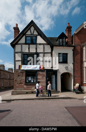 The Festival Office in a half timbered black and white tudor building in the Close of Lichfield Cathedral on 6th - Stock Image