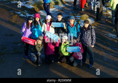 Group of Korean trekkers posing for a picture on the summit of Poon Hill, Annapurna region, Nepal. - Stock Image