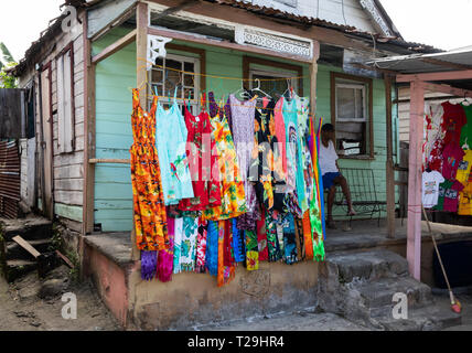 A lady sells clothes on her doorstep in St Lucia, The Caribbean - Stock Image