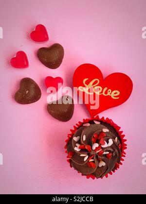 Love heart sweets and cake - Stock Image