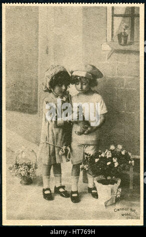 GERMANY - CIRCA 1914: A promotional postcard (Carmol tut wohl) printed in Germany, shows a boy and a girl looking - Stock Image