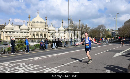 Brighton, Sussex, UK. 14th Apr, 2019. Early runners pass by the Royal Pavilion as they take part in this years Brighton Marathon which is celebrating its 10th anniversary Credit: Simon Dack/Alamy Live News - Stock Image