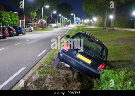 A car had driven into a ditch - Stock Image