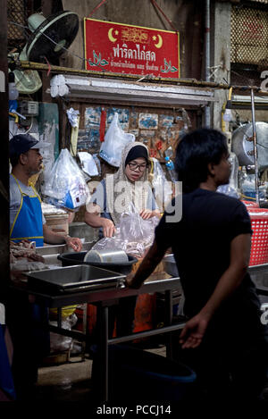 Muslin meat stall advising chicken only for sale, strictly no pork. Thailand backstreet indoor market. Southeast Asia - Stock Image