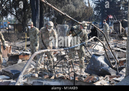 Soldiers from the 40th Military Police Company search through the ashes in Santa Rosa in search of victims of the - Stock Image