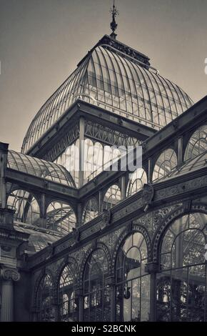 A retro effect image of The Palacio de Cristal (Crystal Palace) in Madrid's Buen Retiro Park. Constructed in 1887, originally used as a greenhouse, but now hosts art exhibitions. Photo © COLIN HOSKINS - Stock Image