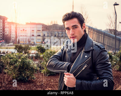 One handsome young man in modern city setting - Stock Image