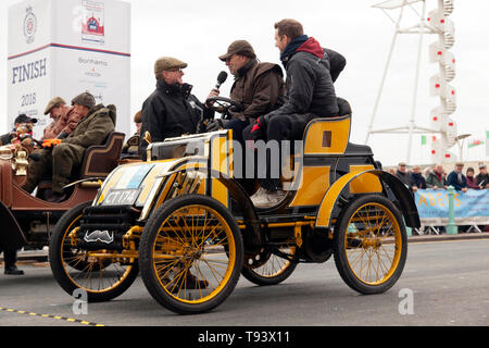 Mr Robert Hadfield in his 1901 Pick, being interviewed at the end of the 2018 London to Brighton Veteran Car Run - Stock Image