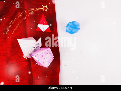 Christmas Decoration with diamond gift boxes and red scarves cloth with snow for holidays best background image - Stock Image