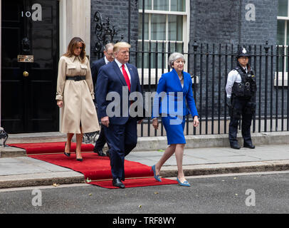 London, UK. 4th June, 2019. President Trump walks with Theresa May, followed by Melania Trump and Philip May across Downing Street to the Foreign Office for a press conference during his Three day State visit to the UK. Credit: Keith Larby/Alamy Live News - Stock Image