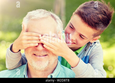 grandfather and grandson playing at summer park - Stock Image
