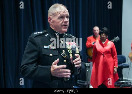 Commandant of the Marine Corps Gen. Robert B. Neller speaks to guests before an evening parade at Marine Barracks Washington, Washington D.C., Aug. 31, 2018. Gen. Neller hosted the parade and the guest of honor was Dr. Betty Moseley Brown.  (U.S. Marine Corps photo by Sgt. Olivia G. Ortiz) - Stock Image