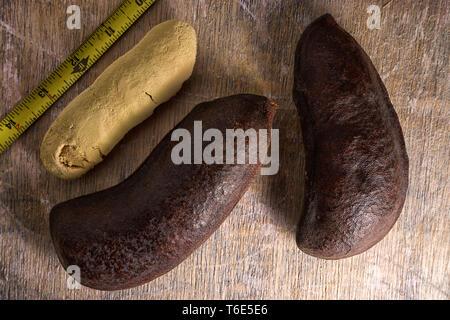stinking toe fruit closeup on wood surface - Stock Image
