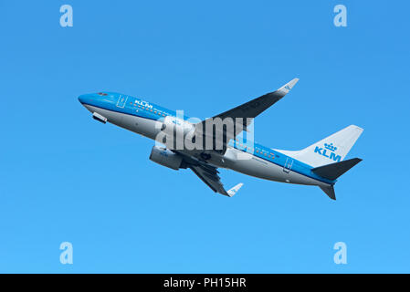 A KLM Boeing 737-K2 on its daily service between Inverness Scotland and Amsterdam in Holland. - Stock Image