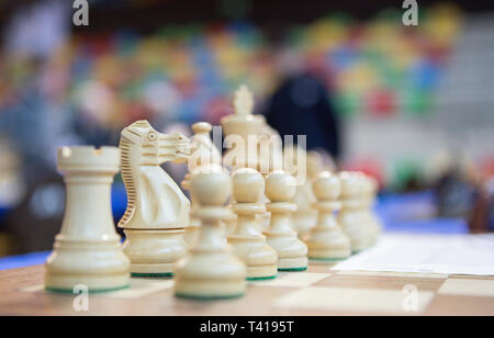 Close-up of chess pieces on a chess board - Stock Image