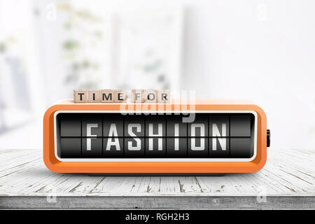 Time for fashion message on a retro clock in a bright room on a table - Stock Image