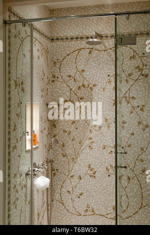 Ornate mosaic tiles in shower - Stock Image