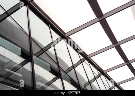 Black and white modern building roofing struts and clear glass panels found in many modern architectural designs - Stock Image