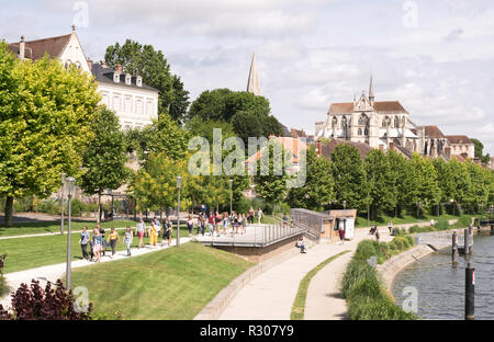 A group of young people walking along the riverside in Auxerre, Burgundy, France, Europe - Stock Image