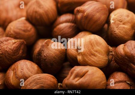 Hazelnut background or texture, heap of peeled hazelnuts - Stock Image