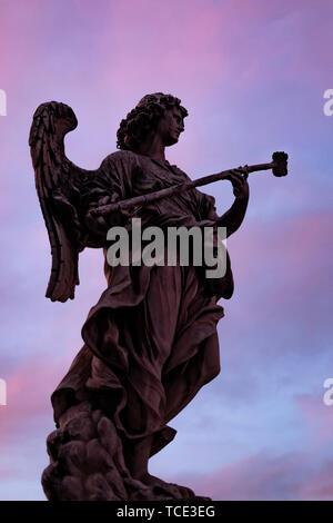 Sculpture on Castel Sant'Angelo bridge at sunset, Rome, Italy - Stock Image