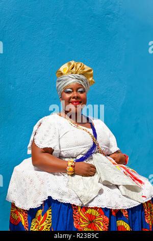 Bahia, Brazil - December 2011: Woman in traditional Bahian dress, Salvador de Bahia, Pelourinho historic district, - Stock Image